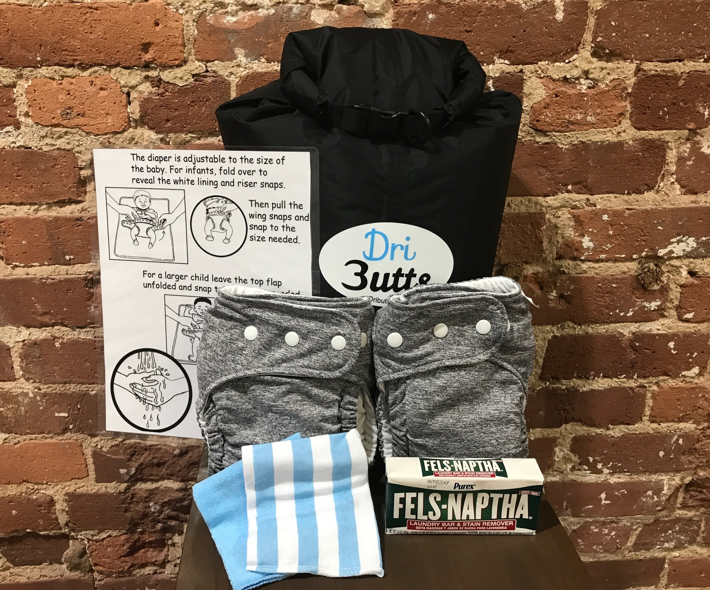 Each pack is a donation of $40 and will consist of the following: - - 2 DriButts Diapers- 1 5L Dry Bag- 1 Bar of Laundry Soap- 2 Wash Cloths- 1 Laminated Instruction Card