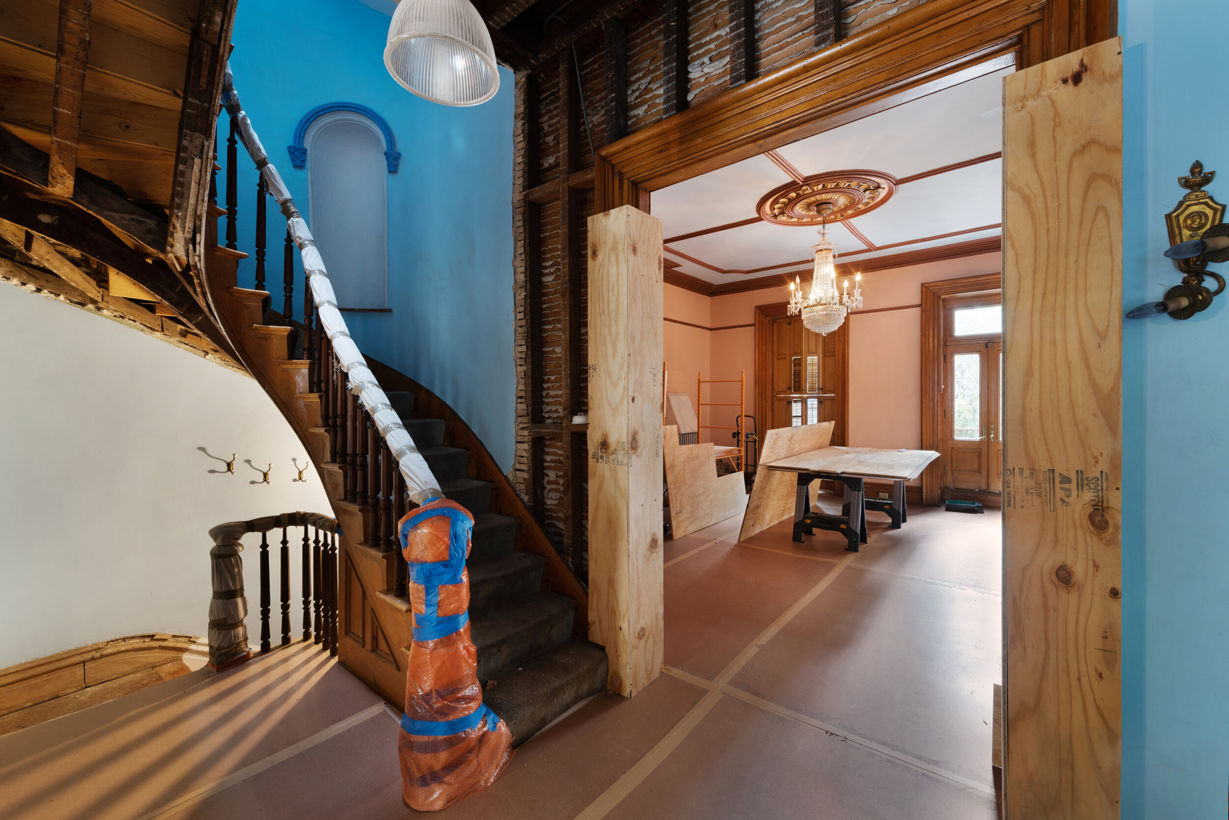 The home features a delicately curved mahogany bannister and stairs.