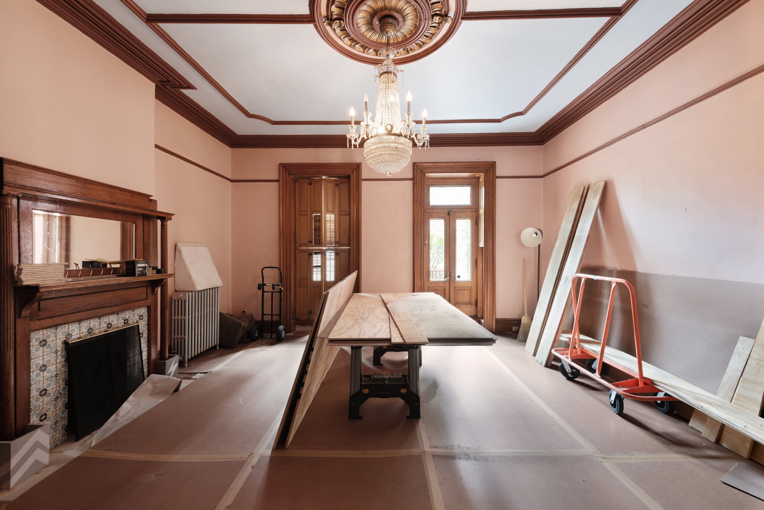 Natural light streams through the parlor as the home is prepped for renovations.