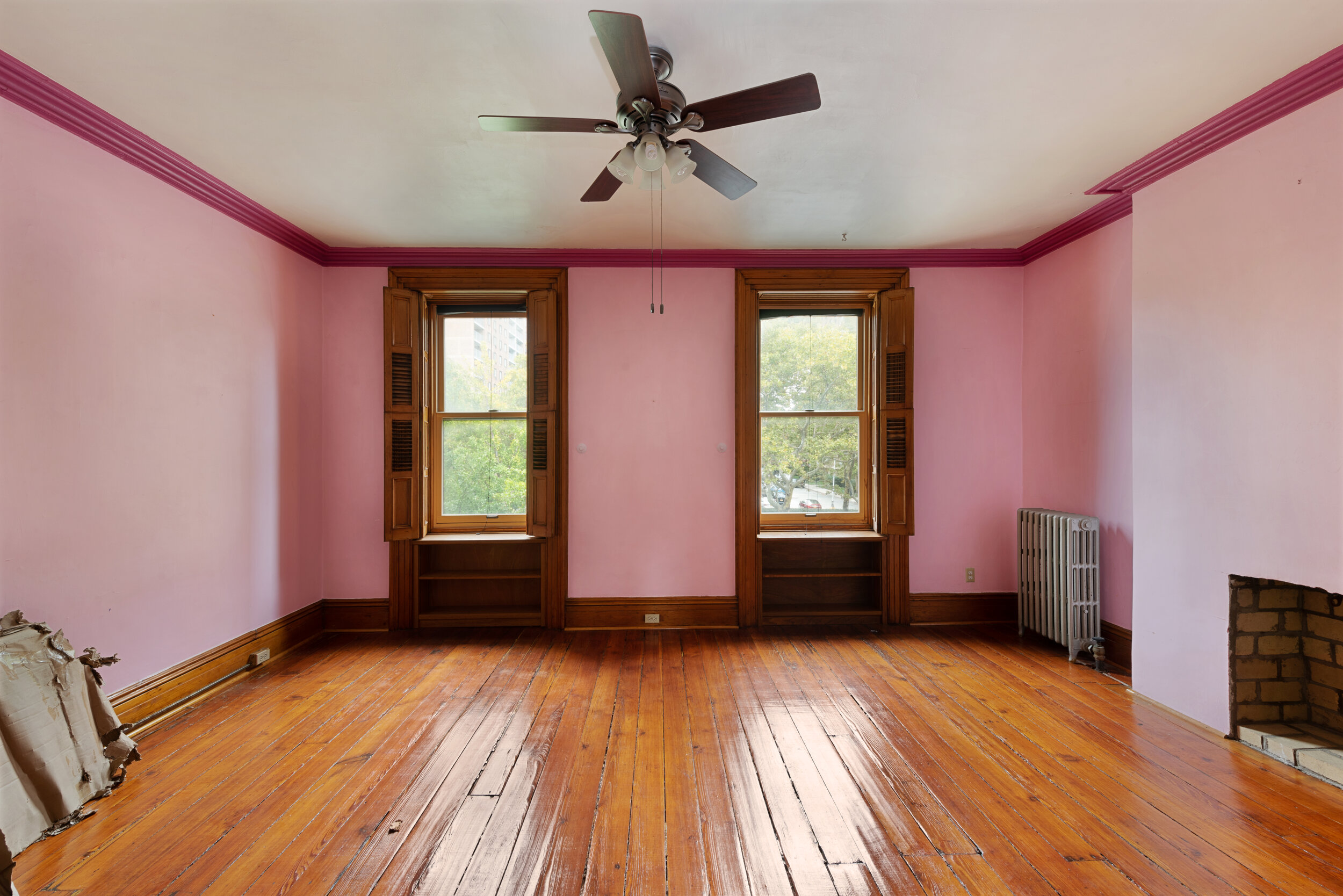 One of the four bedrooms in the home, pre-renovation.