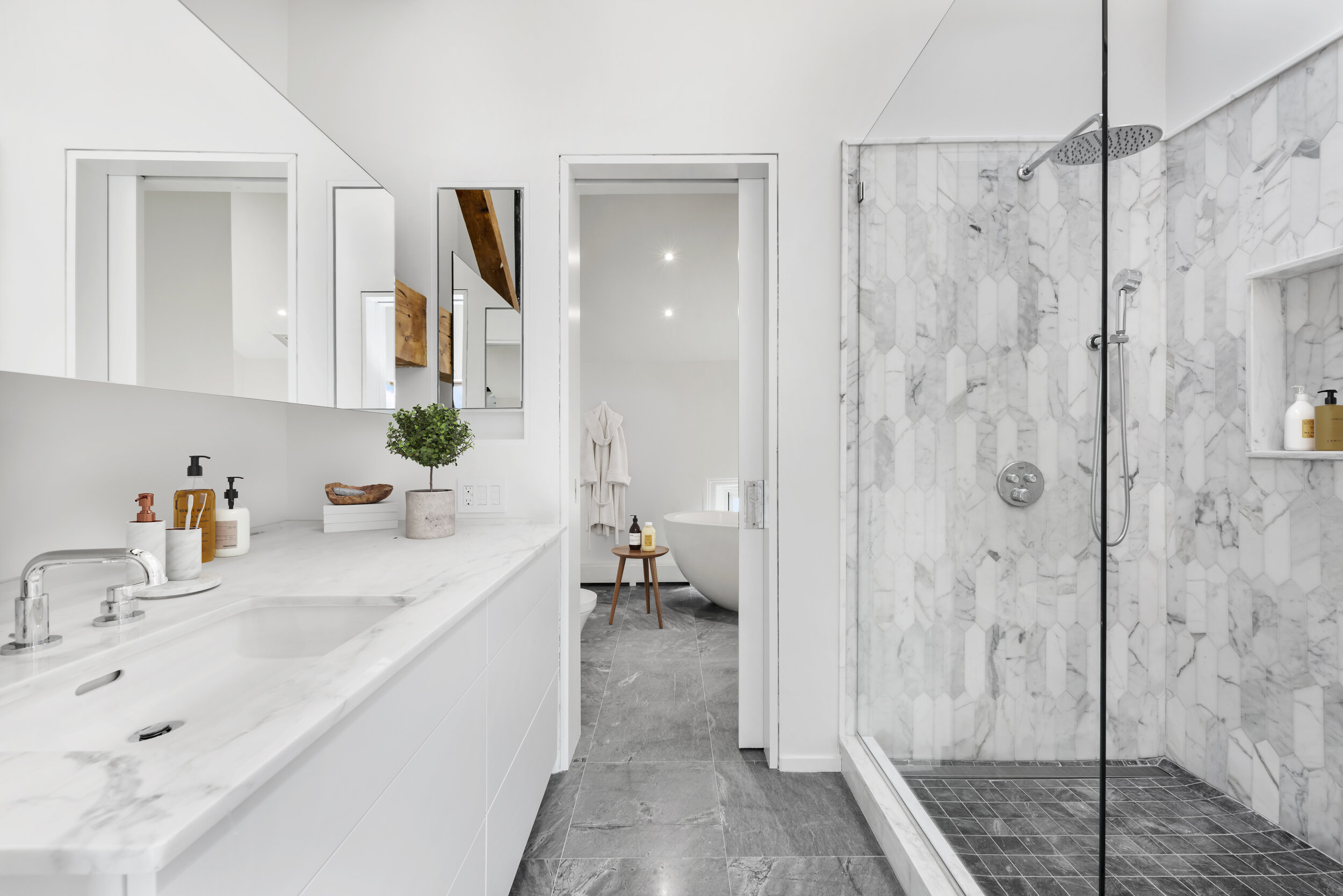 The homeowner, a designer with impeccable taste, selected custom tiles for each bathroom.