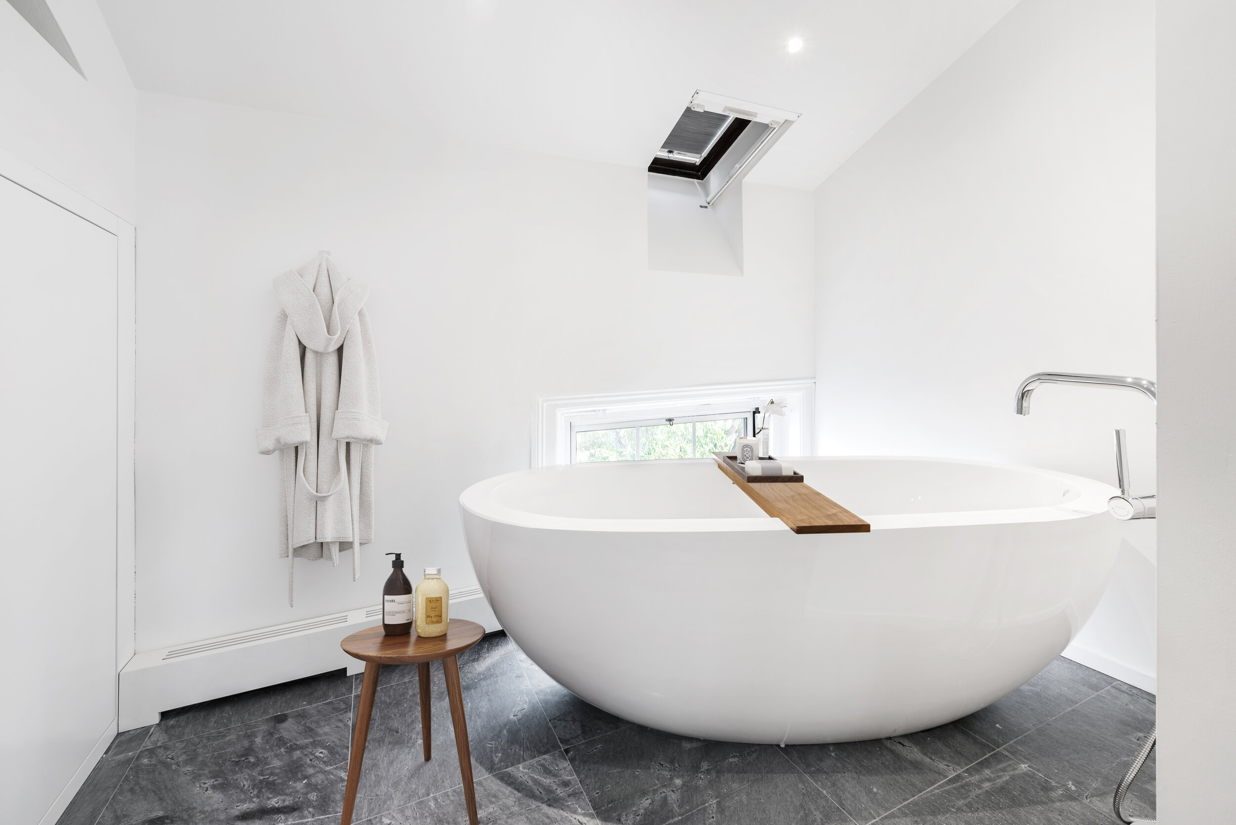 The homeowners invested in a tranquil master bathroom that included a freestanding soaking tub.