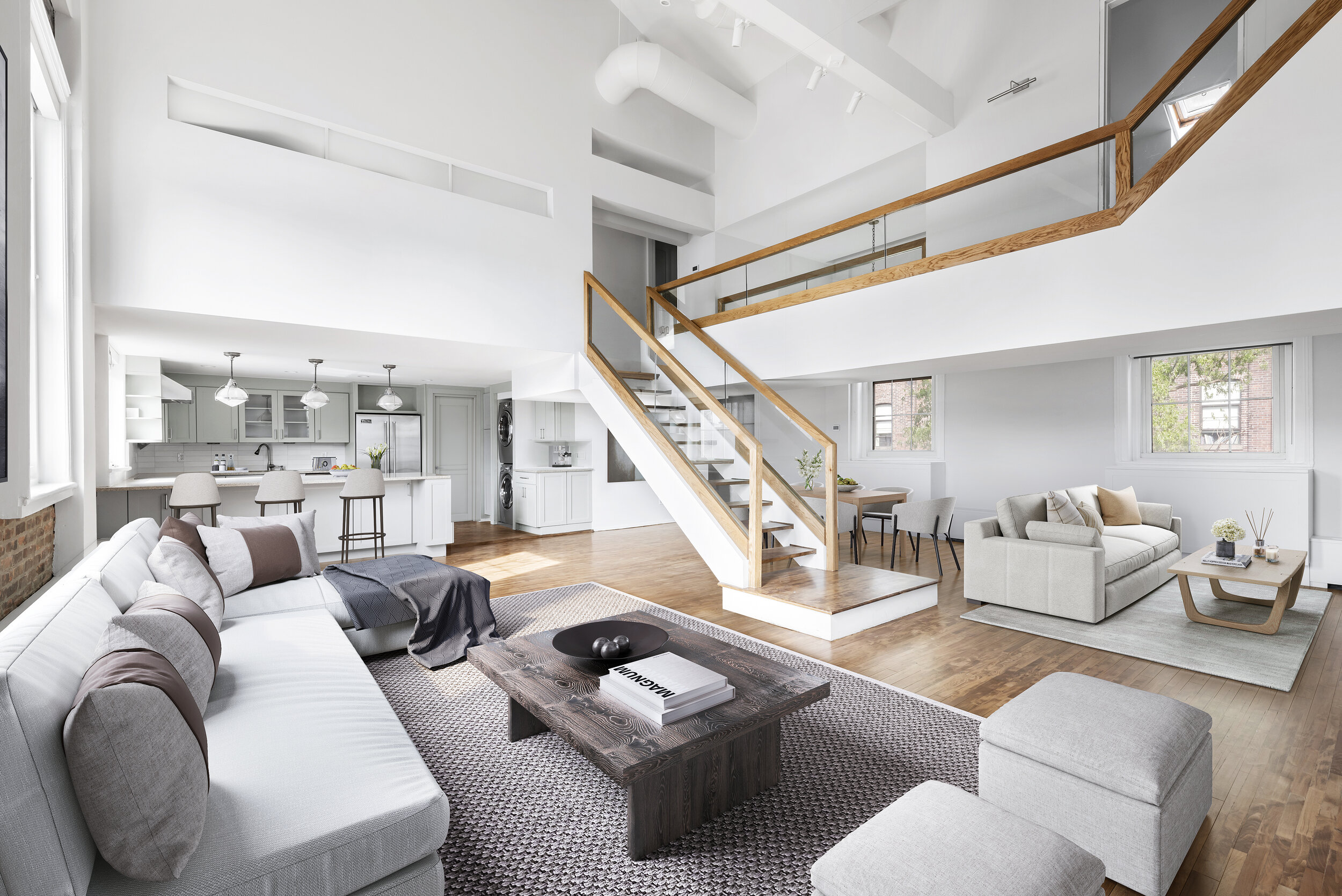 The custom-designed timber and glass staircase is a warm and modern focal point of the loft.