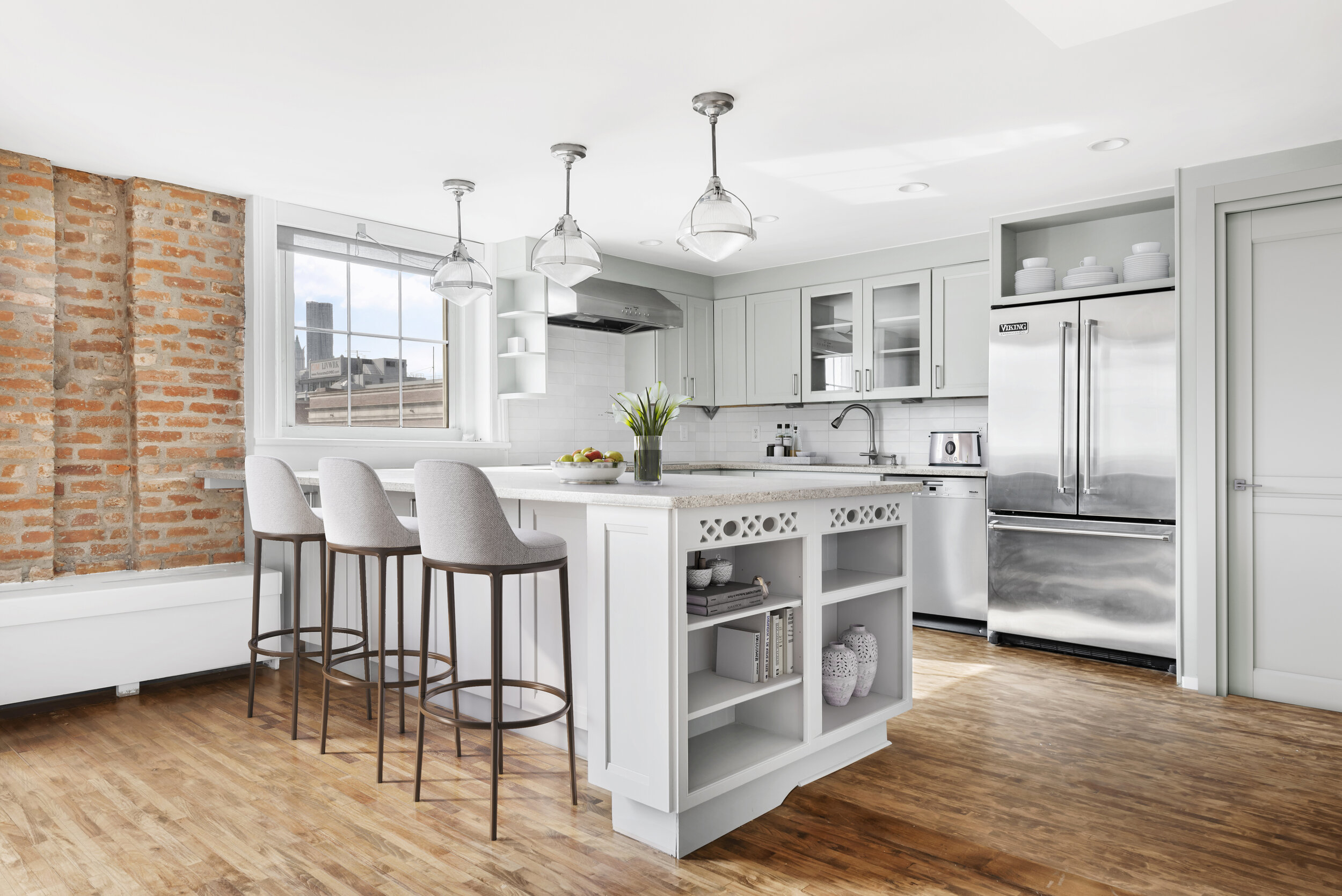 The homeowners took a practical approach to renovating the kitchen, which was given a simple, cosmetic refresh with fresh paint and custom tile backsplash.