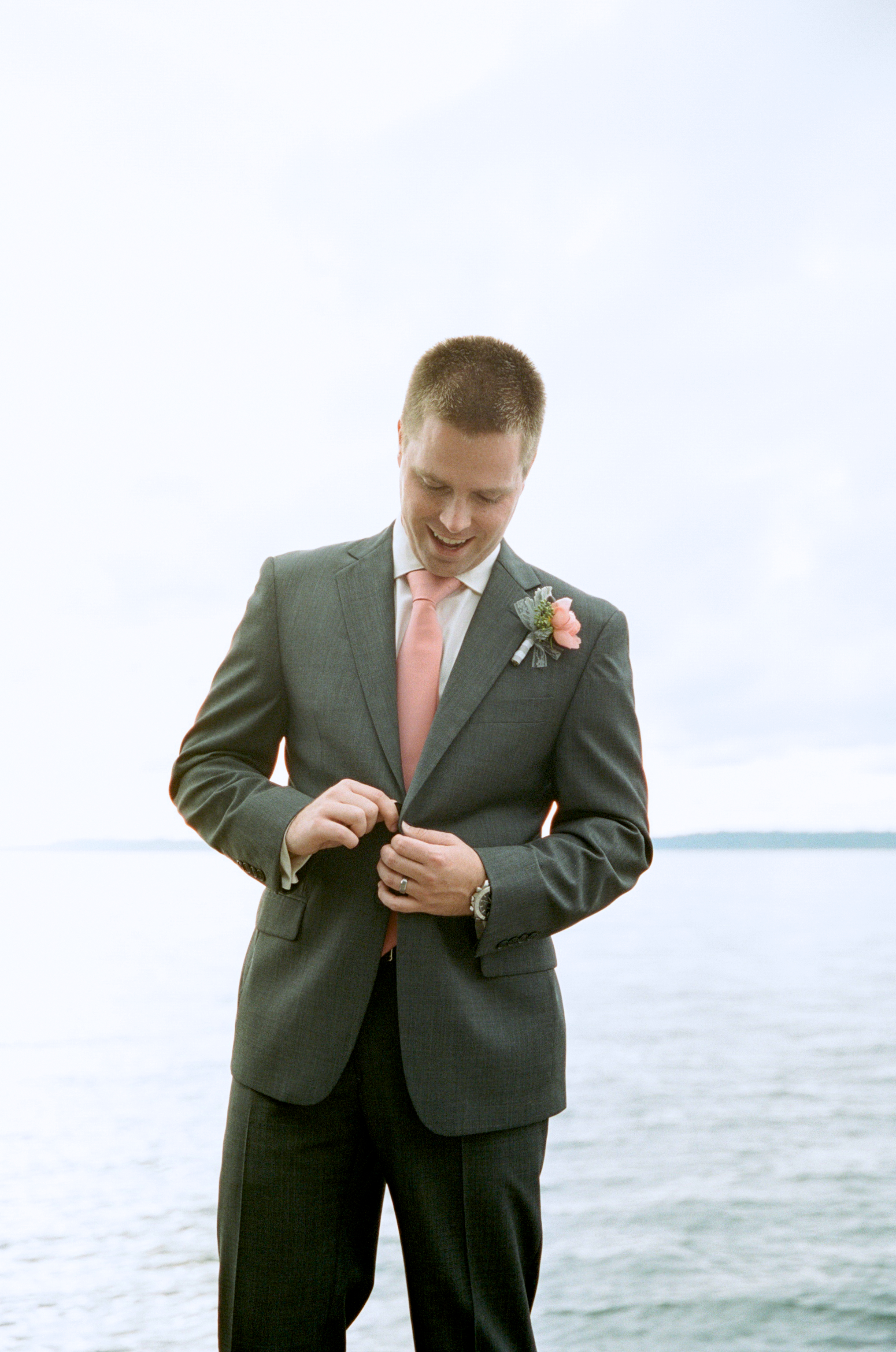 seattle wedding photographer photography rachael kruse ocean pudget sound the hall at fauntleroy film photographer engagement west seattle groom water