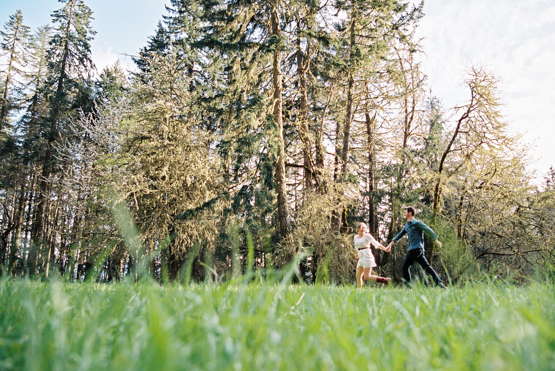 seattle wedding photographer engagement photo photos eugene oregon spenders butte woods trees grass light sunlight sun film photographer running in field