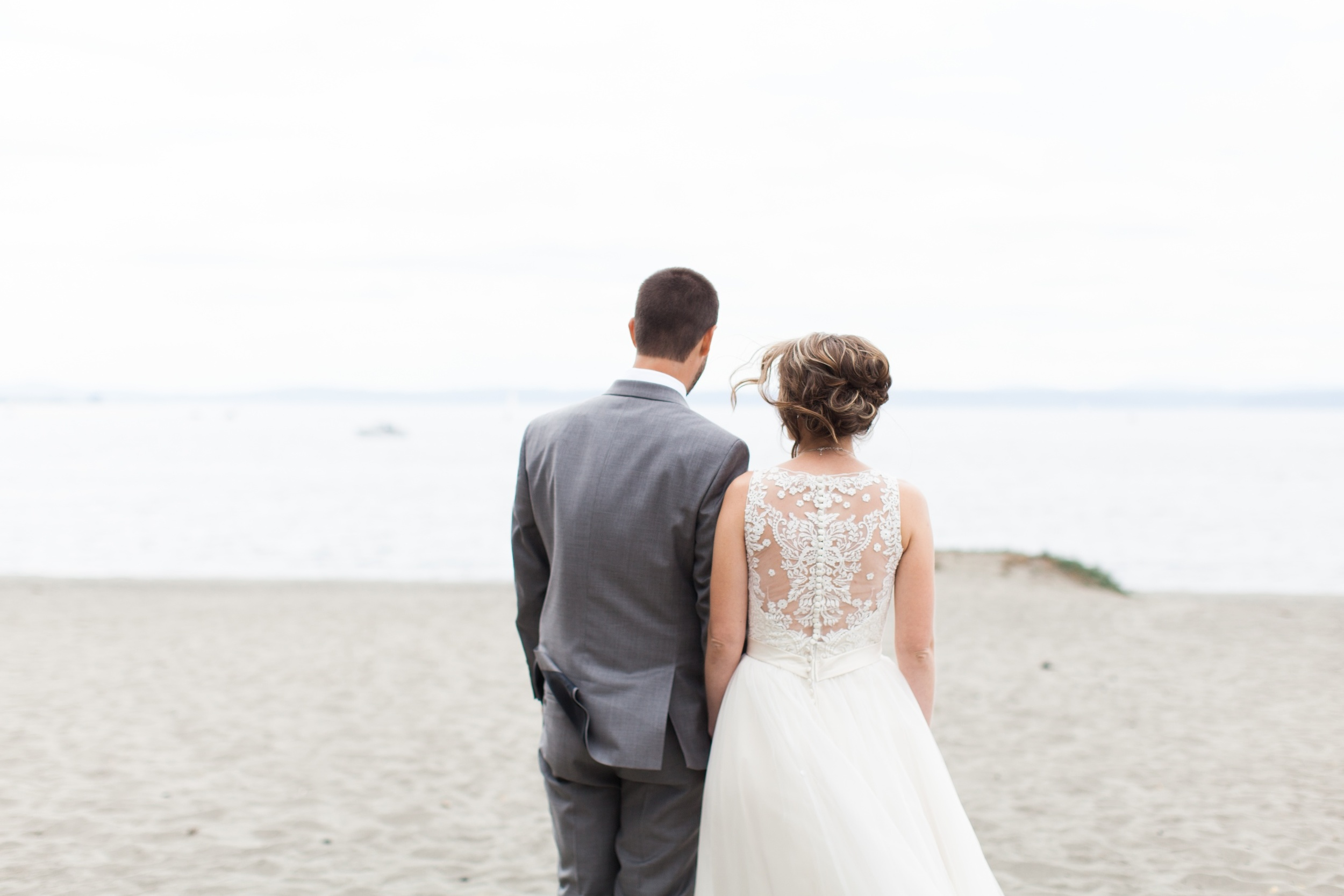 Seattle wedding photographer film photography golden garden gardens state park ocean beach sand grass wind boat house boathouse bride and groom looking out at ocean pudget sound