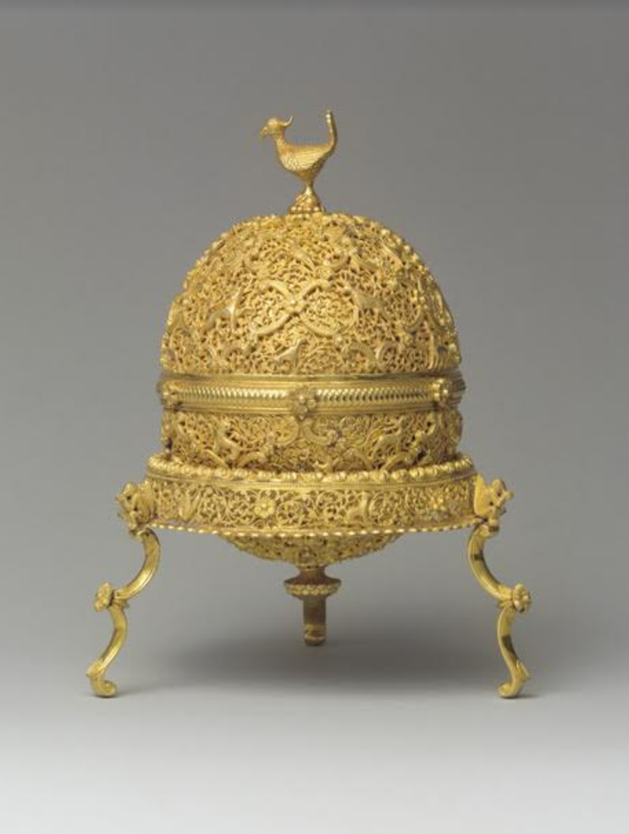 Goa stone and container - Goa stone and container, late 17th–early 18th century. The egg-shaped gold container enclosing this stone consists of hemispherical halves, each covered with a layer of pierced, chased, and chiselled gold foliate openwork. An arabesque surface pattern is overlaid with an ogival trellis containing a variety of beasts, some highly Europeanised, including unicorns and griffins. A British officer in the East India Company brought this example to England in the eighteenth century. Photo credit: Metropolitan Museum of Art