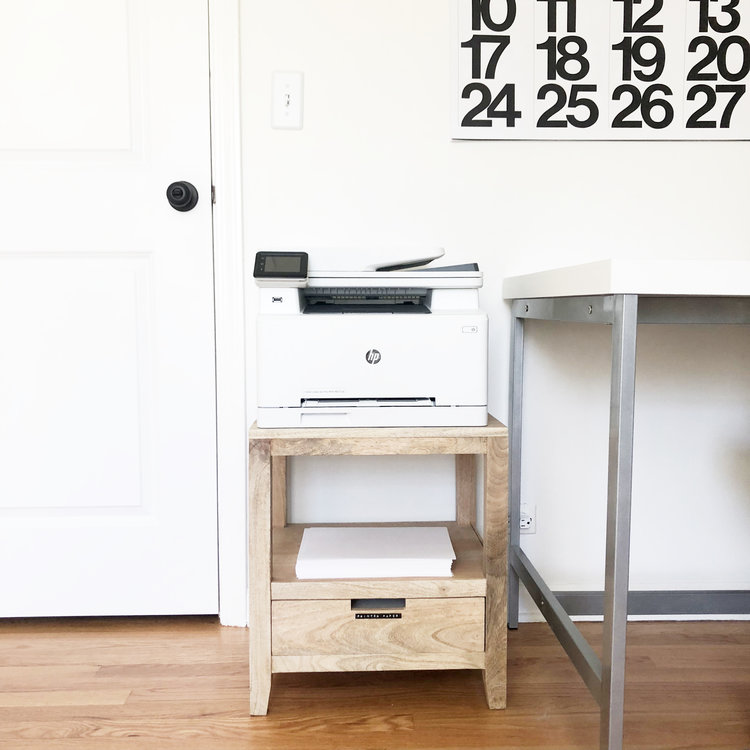 End Table   If you have a printer in your studio, placing it on a table makes all the difference. You don't want to waste precious tabletop space for this monstrosity. Also, an end table keeps it more out of sight.