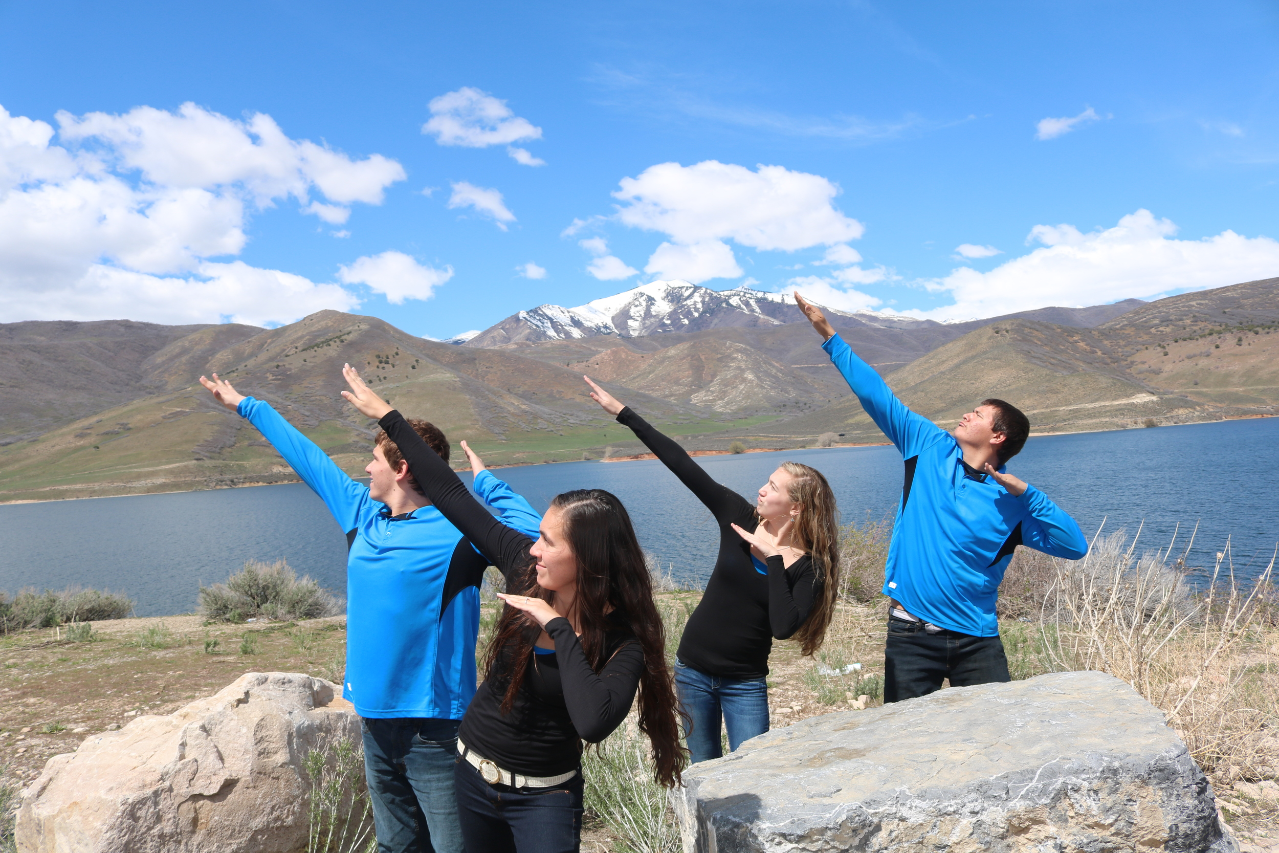 """April 2016 Koleden, Brenna, Taylee, and Kyler. Provo Canyon. The kids have fun with a """"cousin pose."""" We were taking family pictures. Our kids tend to find """"fun"""" where ever they are. We have been on many vacations that have been cry or laugh and we have chosen to laugh. The girls have learned to be great sports about it. Brenna is getting married in October and we are fortunate to be gaining another wonderful son."""