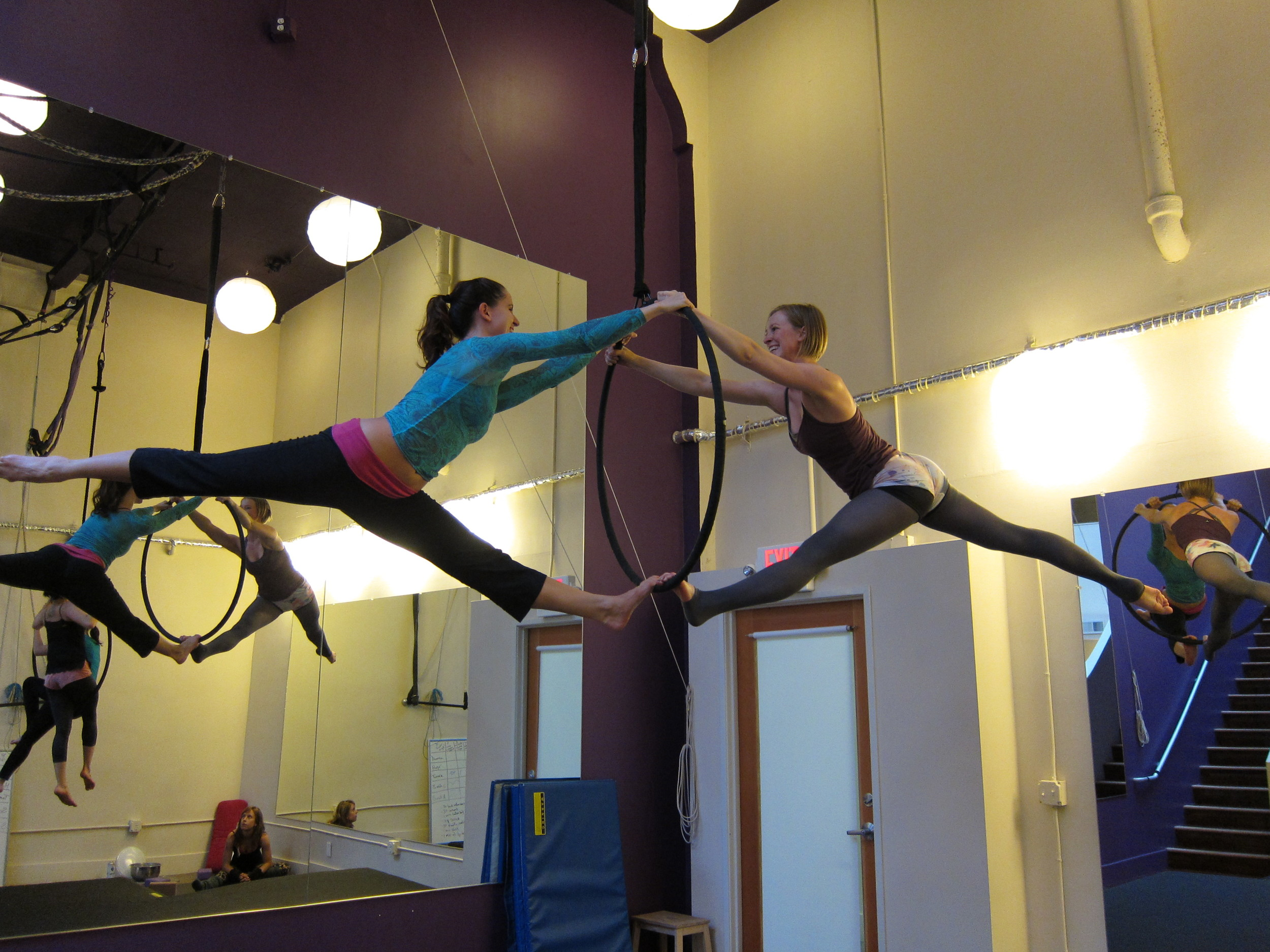 Tamara (l) and Sarah (r) practice chopsticks   Night Flight Aerial