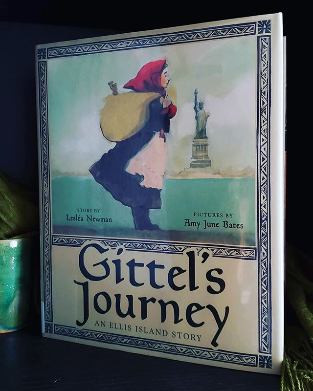 Gittel had already been prepared to leave her belongings, her best friend Raisa and her goat Frieda behind, that—at 9 years of age—she'd have to sail to America without her mother was unexpected. It isn't safe to stay until Mama can pass the medical evaluation—and we can conclude why.  Amy June Bates work is always stunning. The woodblock stamped frames and title page illustrations are gorgeous. Bates literally frames the text with a sense of the historic and cultural. The portraiture in Gittel's Journey is remarkably effective in translating the feeling of something past while experiencing all the emotion in the present. Families shouldn't have to flee, be separated, or be kept so vulnerable when they do and are.  I love Gittel's invitation at the close. Her journey was incomplete without Mama and those tall white candles. And it is now her turn to call her mother home and to the lighting of the candles.  Gittel's Journey is a treasure in text and illustration; two masterful portrait artists capturing a time so presently felt.  #gittelsjourney #amyjunebates #lesleanewman @abramsbooks 2019. full #bookreview link in profile. #leslied #picturebooks #historicalfiction #childrensbooks #jewishamericanheritagemonth