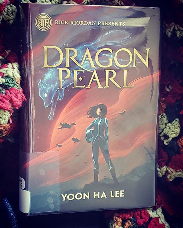 """Yoon Ha Lee does a couple of things in the story that impresses me. The world-building involves more than just populating it with supernatural creatures from mythology, the lore is built into the world's very fabric and its technologies. The author isn't afraid of nuance. Few, if any character, is glowingly good or evil. Yoon Ha Lee doesn't create their hero out of thin air, or even convenience. [...] The use of shape-shifting and limited perception strengthens thematically as the novel continues and we try to navigate folk's intentions and facades.  Yoon Ha Lee does not create conflict or solutions out of thin air either. They are willing to go to some difficult places narratively, but it is ultimately rewarding. Plans do not run smoothly, not everyone can be easily anticipated, and resolutions will cost our protagonist, others, and the reader (I cried). I can't wait to read the next installment.  Min is a force of nature, as is her adventure to rescue both her brother and herself. The Dragon Pearl is an object that may be initially perceived as an innocuous excuse for an adventure, but it has serious political dimensions: power and survival. And I suppose Yoon Ha Lee's novel could be read with depths unplumbed, but lines like """"Due to lasting prejudice, they have to hide their true identity."""" And """"It was easier to design starships to human shapes and sizes and have everyone else adapt,"""" makes the novel's conversation rich and relevant. Too, the ideas of sacrifice: which ones are noble and which ones are needless?  Dragon Pearl is fun, imaginative, and compelling. It also carries a good kind of weight in its dialog, characterization, and world-building. It would make for a great book club choice with its broad appeal. Dragon Pearl is also a great way to lure Fantasy readers into the SF genre to experience the space opera; I'm looking at you Harry Potter and Percy Jackson fandoms.  #dragonpearl #yoonhalee @readriordan 2019. full #bookreview link in profile. #leslied """