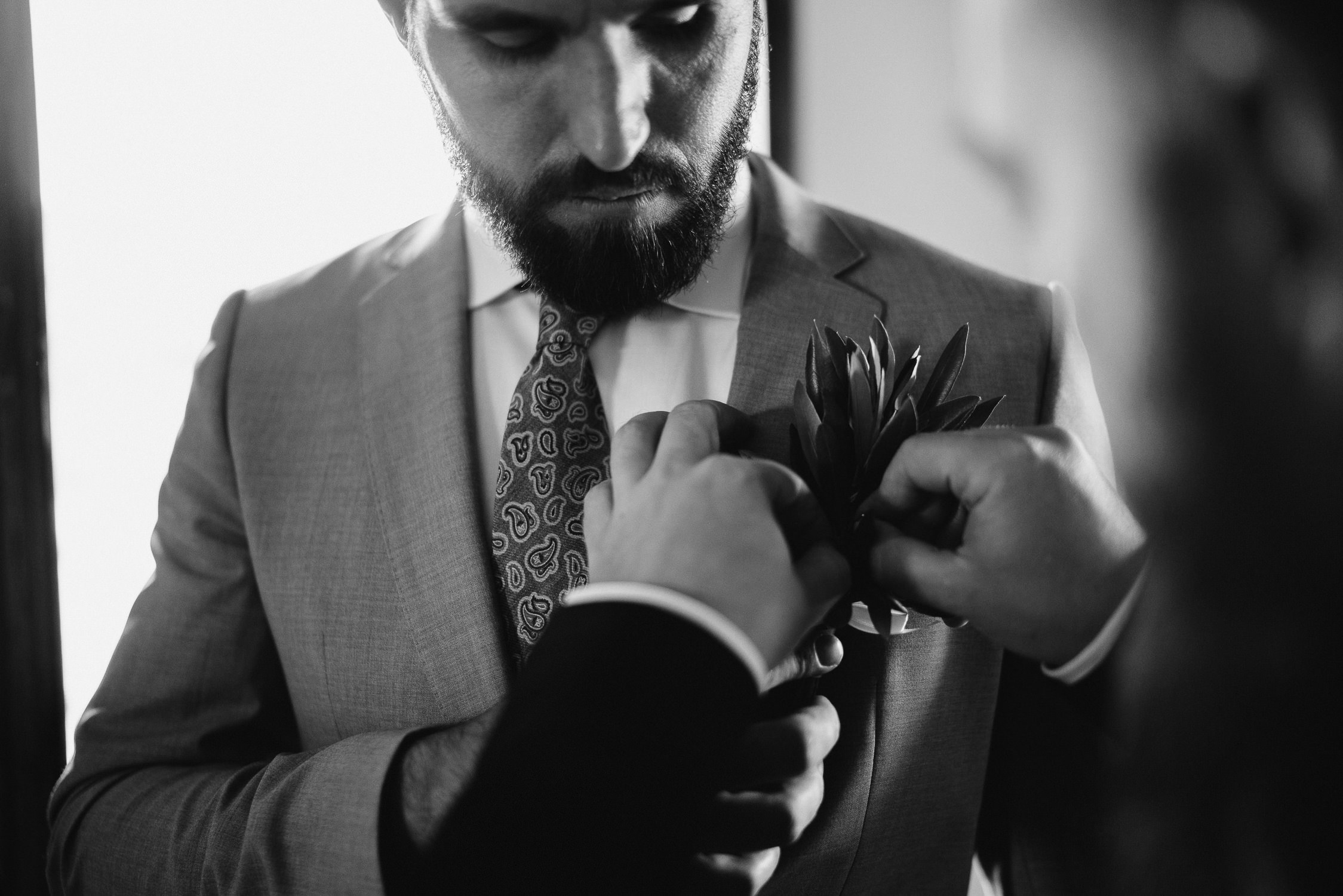 groom getting ready for wedding tuscany photography by mark hadden