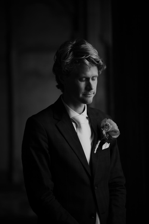 groom portrait in utrecht dom tower by mark hadden wedding photographer