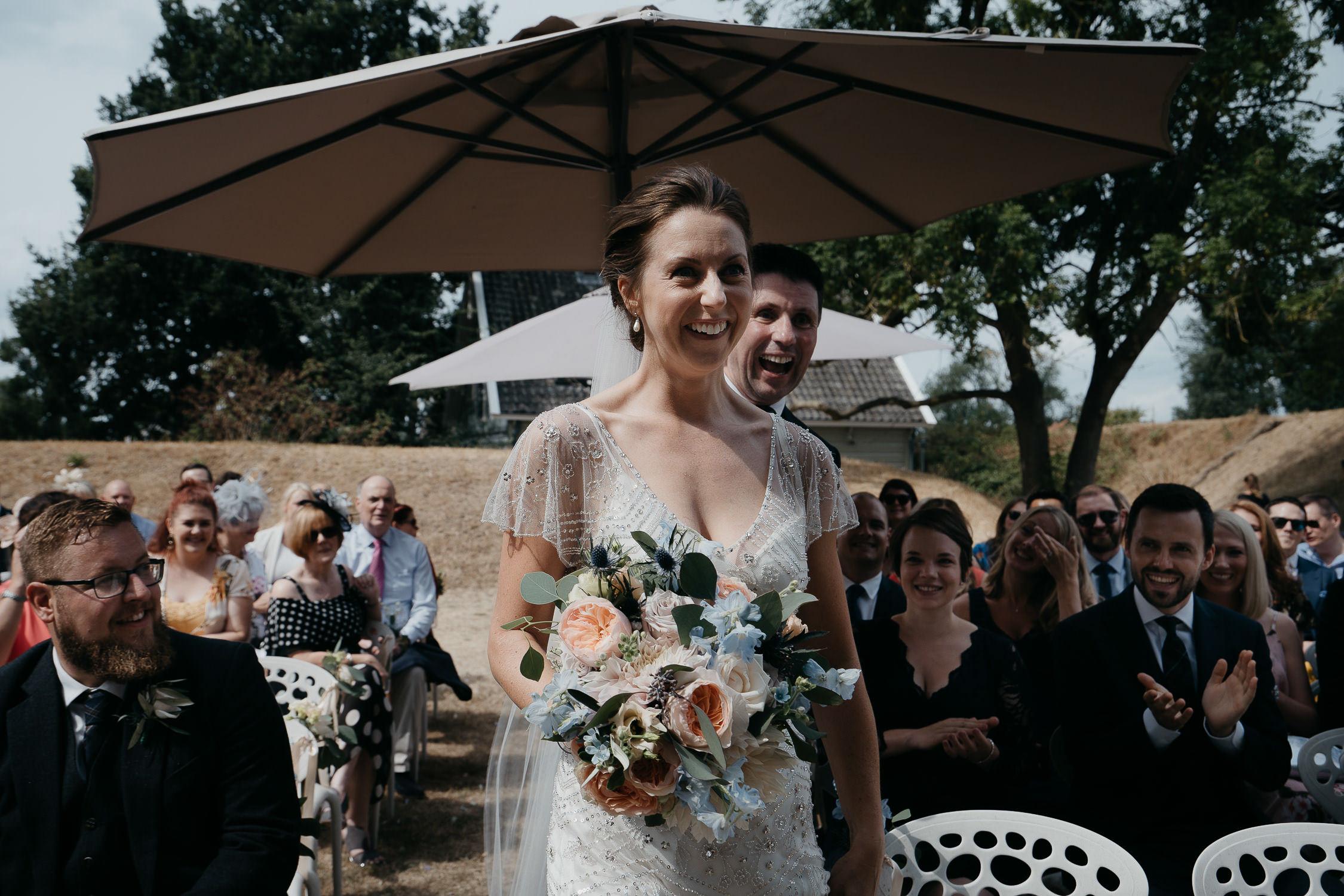 bride walking down isle by wedding photographer mark hadden