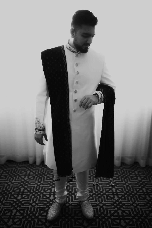 groom prep portrait in tanzania by mark hadden wedding photographer