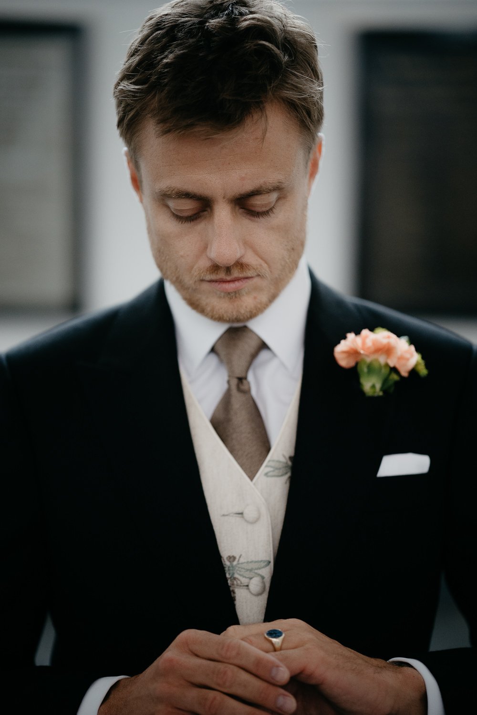 Groom preparing for wedding photography