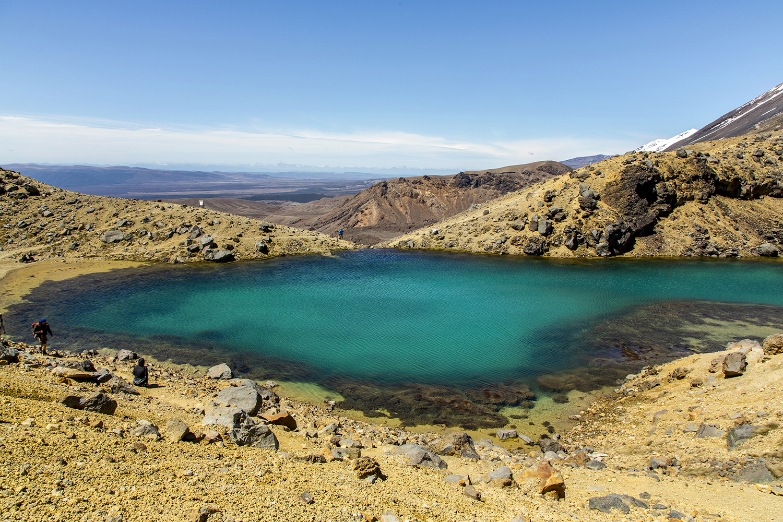 Special to the Democrat-Gazette/Karen E. SegraveHikers walk around one of the Emerald Lakes on the Alpine Crossing in Tongariro National Park, New Zealand.