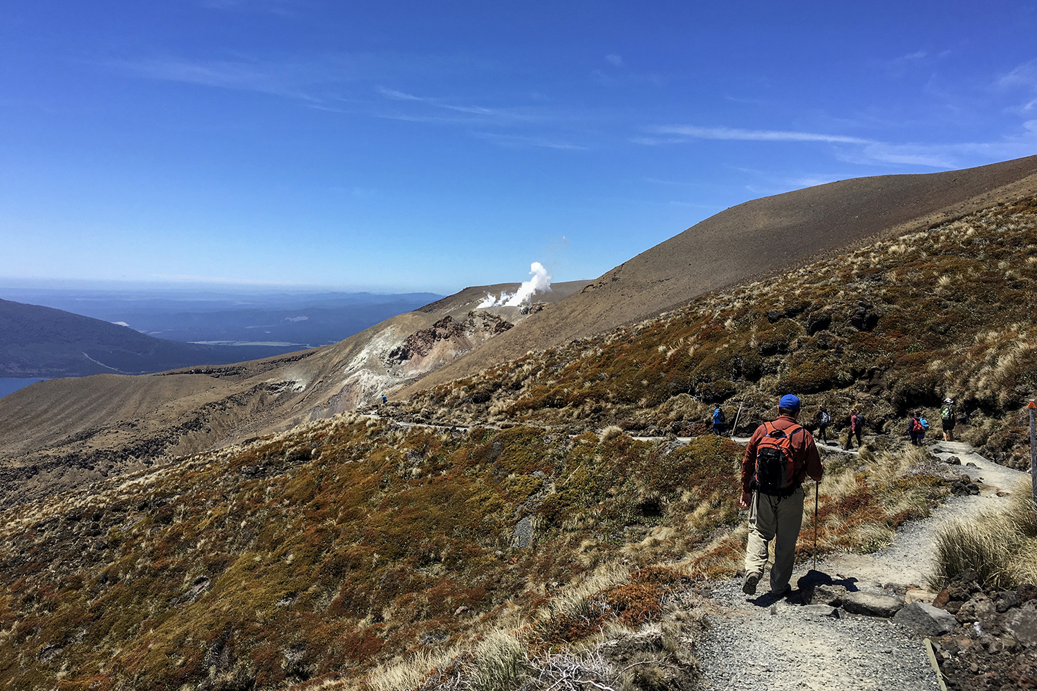Special to the Democrat-Gazette/Karen E. Segrave11/24/15Mike McCall navigates a set of switchbacks on the descent from the highest point, the Red Crater which sits at 1886 meters, on the Alpine Crossing in Tongariro National Park, New Zealand. The crossing descends nearly 1000 meters with no break from here out.