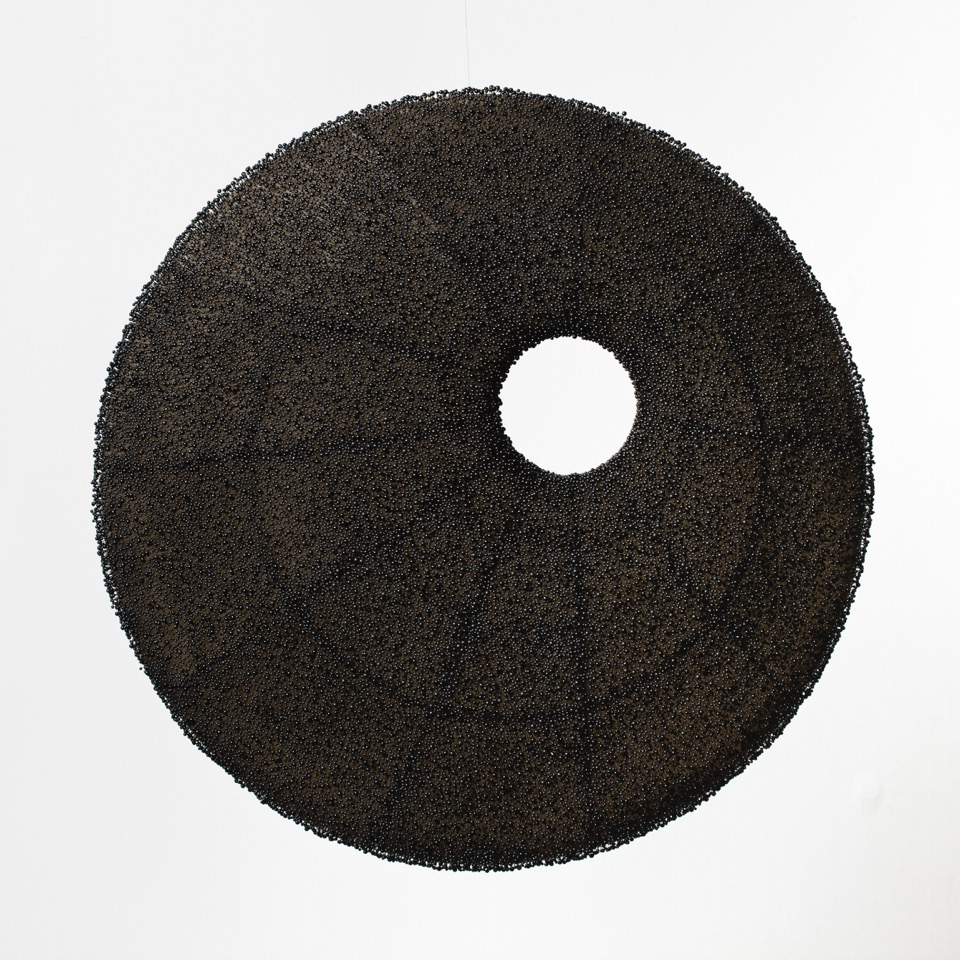Beth Dary, Elements of Ambivalence,  glass pins & wax on linen,24 inch diameter