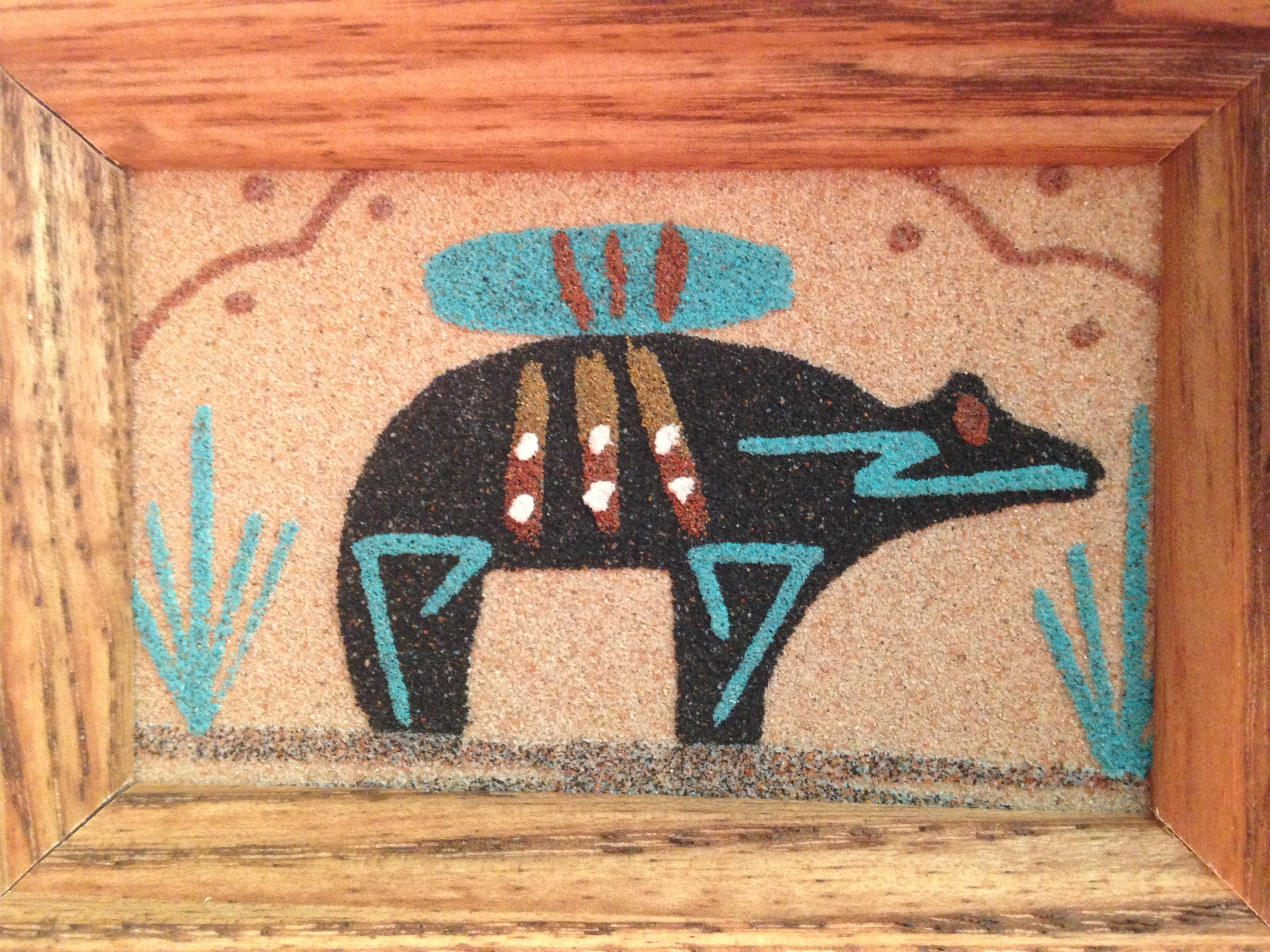 "A sandpainting depicting the Zuni bear ""fetish,"" a guardian spirit."