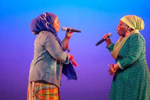 Poetic Pilgrimage performing live on stage.