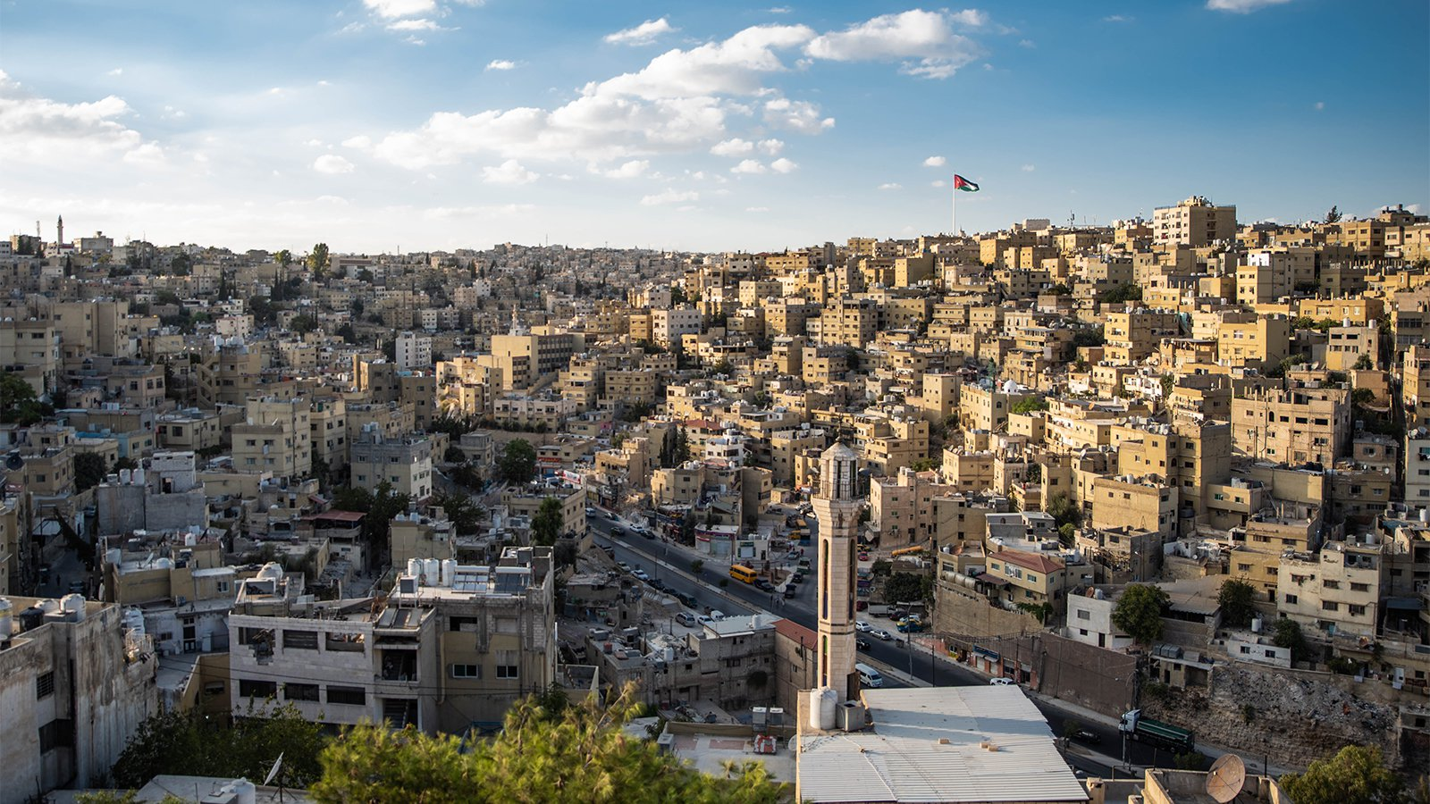 A Jordanian flag flies over the Amman, Jordan, skyline. Photo courtesy of Creative Commons via RNS.