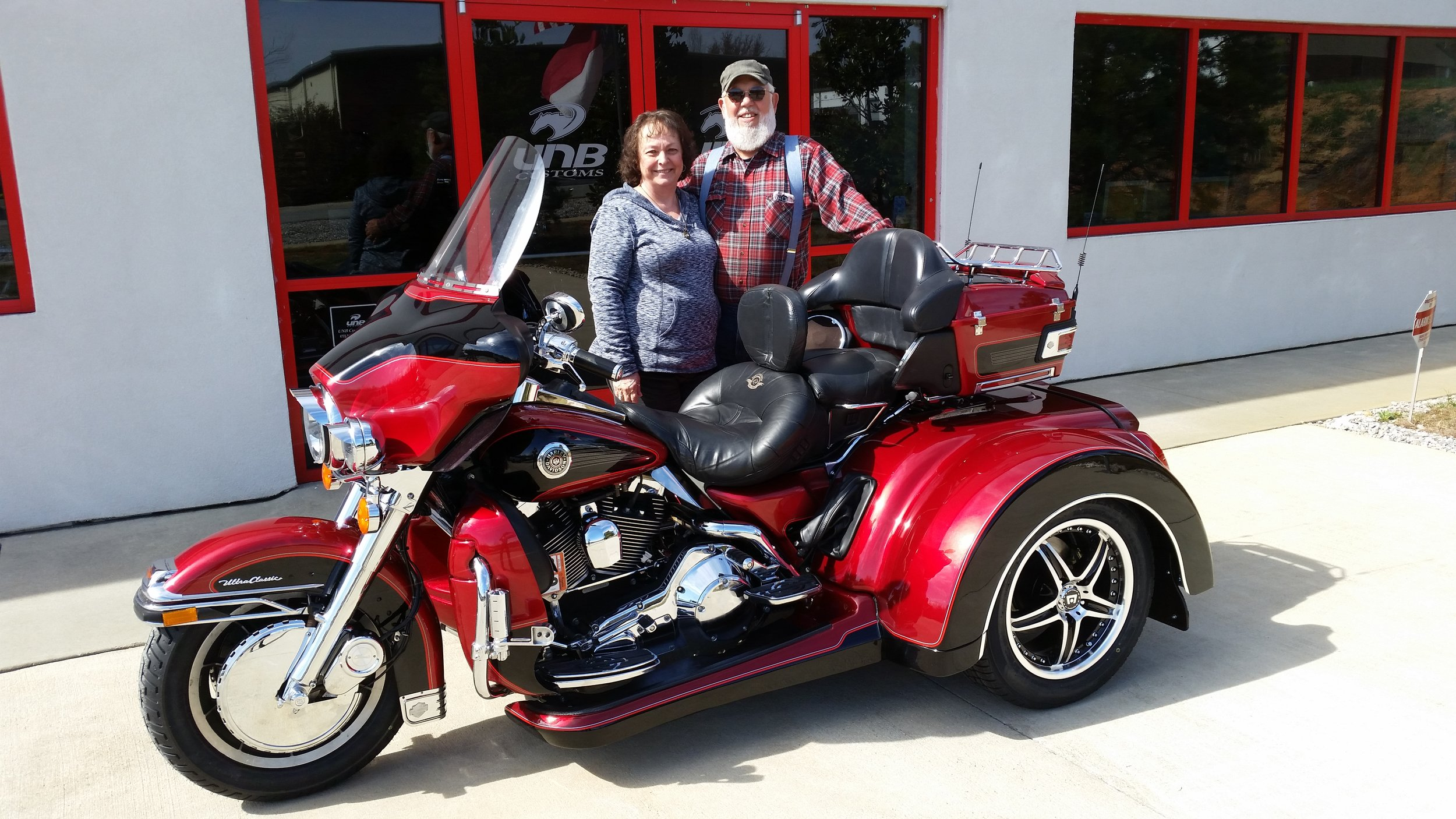 our friends with their Harley Trike custom converted for them.jpg