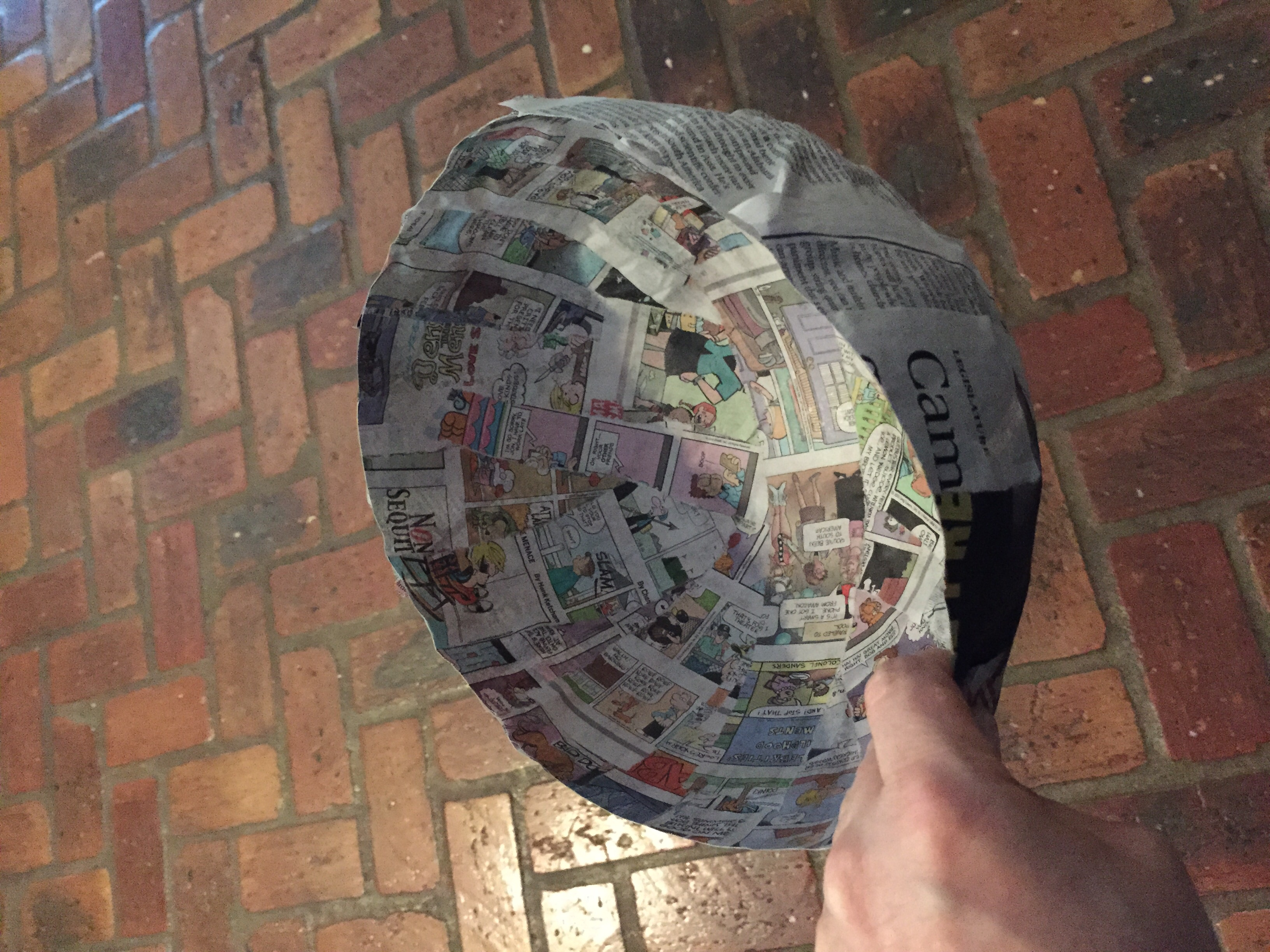 Two coats of paper mache around a balloon.