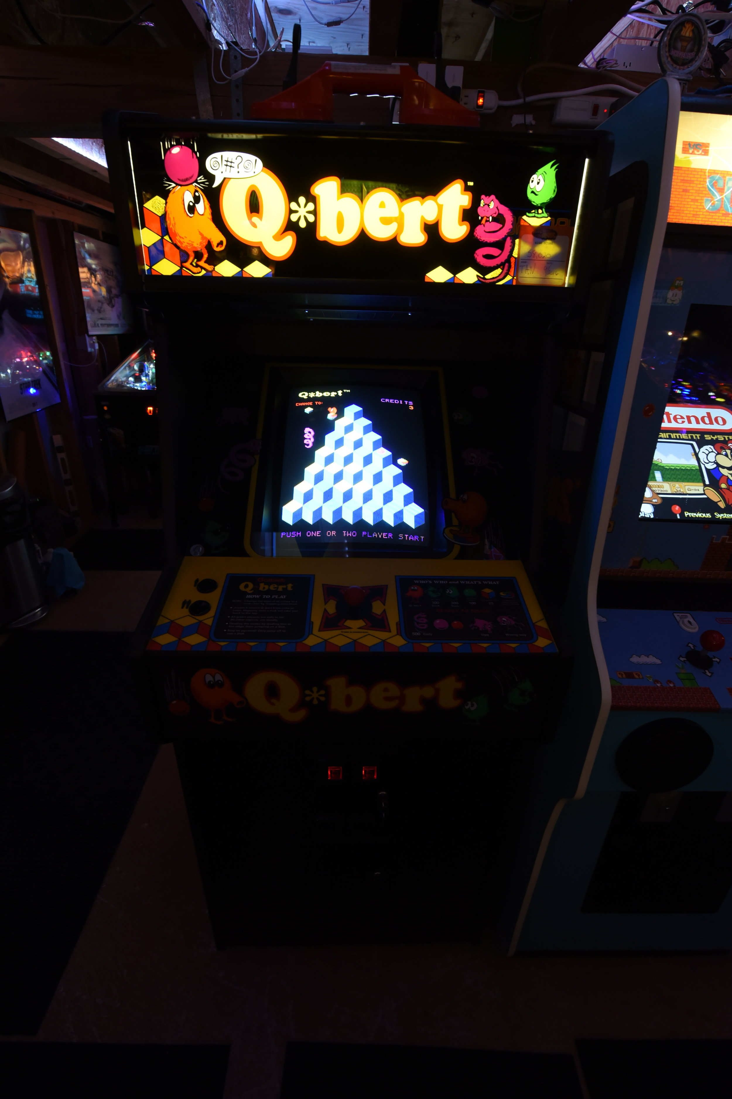 "This is the Arcadeshop remake Q*Bert Cabinet running the Mylstar FPGA boardset. Modern switching power supply and this machine and recently mounted a NIB 19"" CRT w/ a custom-built chassis. The knocker works too! Fun game."