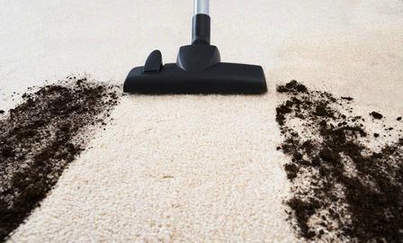 vacuuming dirt off of a carpet