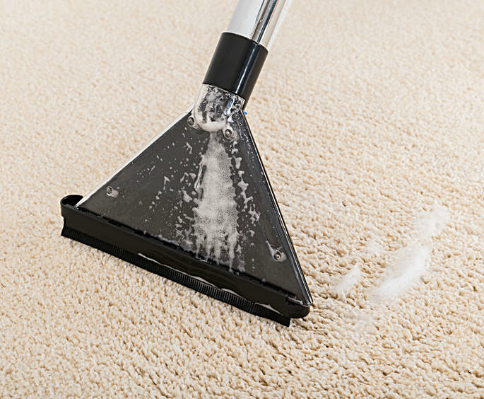 a cleaner on a carpet
