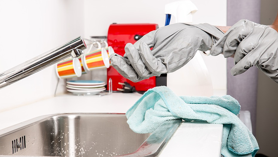 Woman cleaning a sink