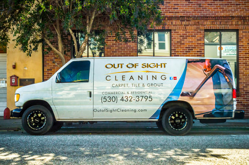 carpet cleaning van in front of building