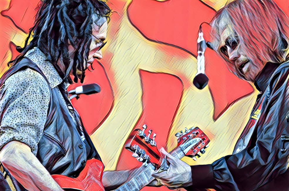 Tom Petty and Mike Campbell on stage at New Orleans Jazz & Heritage Festival in 2012. [Image Credit: flickr user Takahiro Kyono]