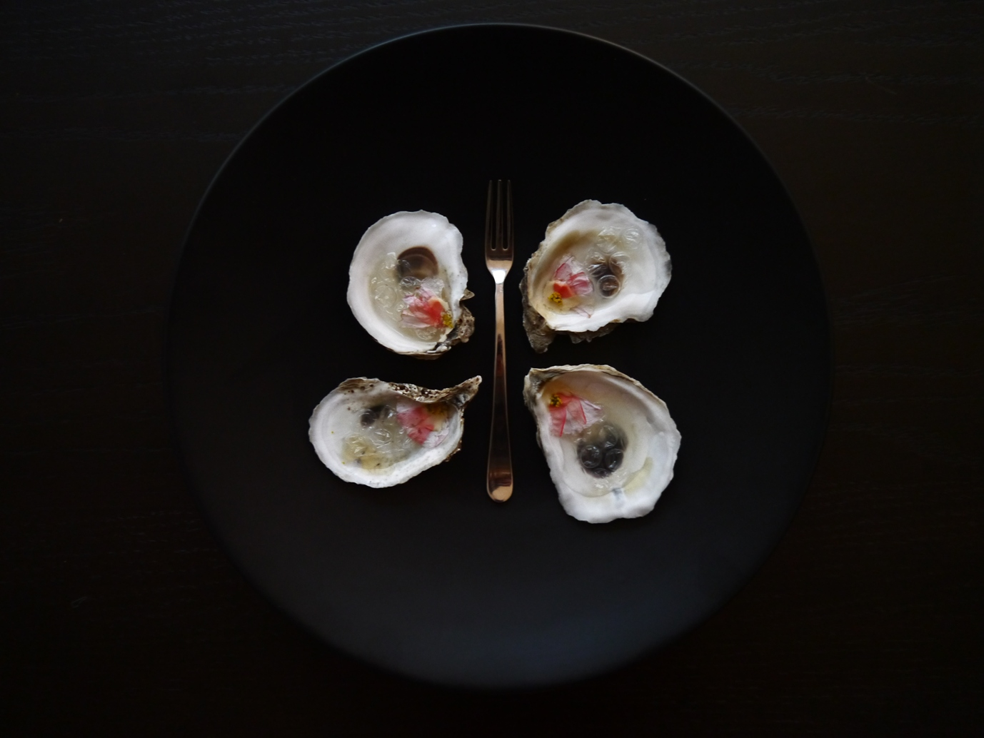 A p p e t i z e r    Kumamoto oyster on a half shell //  empty oyster with bubble wrap and shampoo      Mustard blossoms //  yellow wildflowers      Thai chili //  red pouch netting