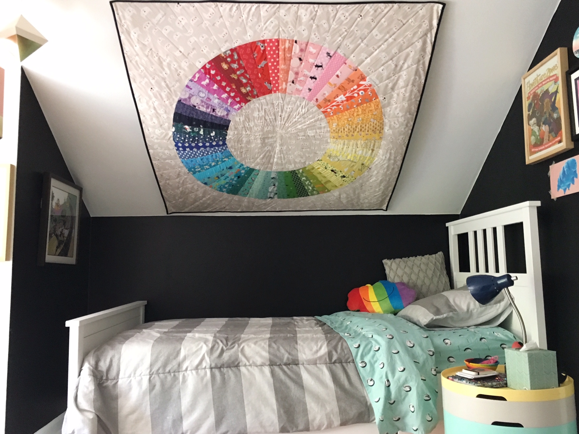Kitty Color Wheel hanging on slanted wall