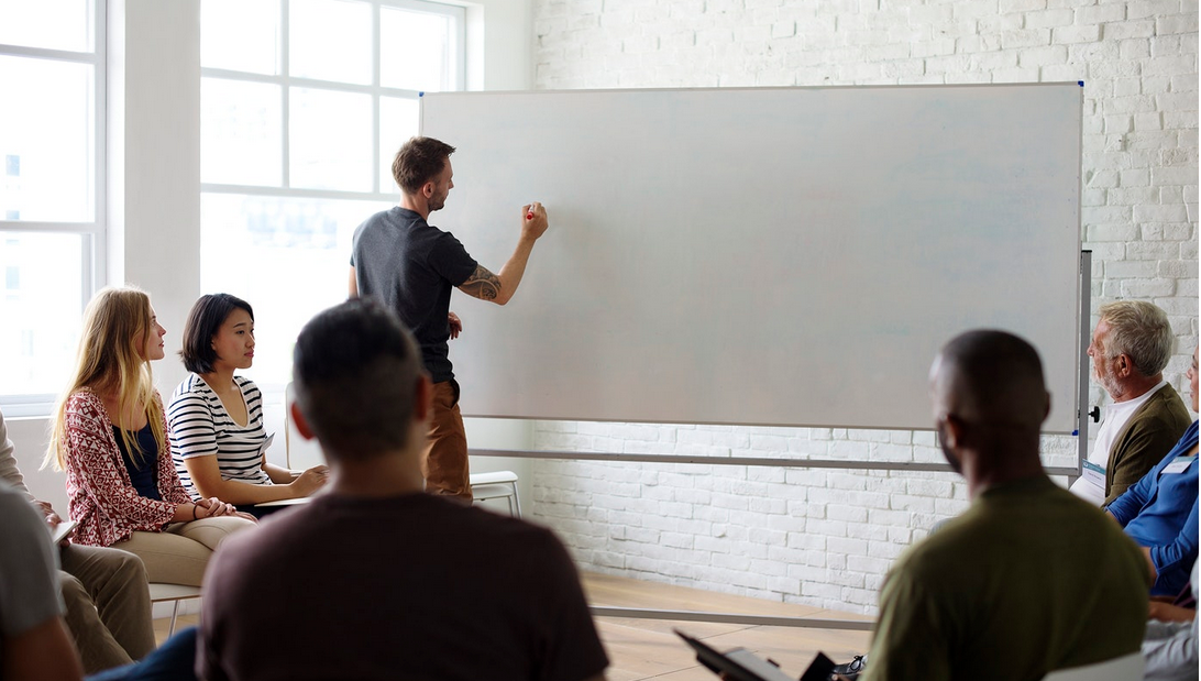 Finally a decent image of 'teaching' happening! And they've ever-so-helpfully left a lovely big copyspace on the board for you to write in whatever you like...
