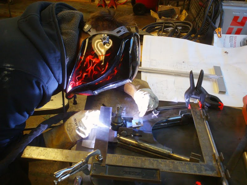 Mr.G TIG welding a custom designed a arm. The arm was attached to a Lotus 7 we built at the school.