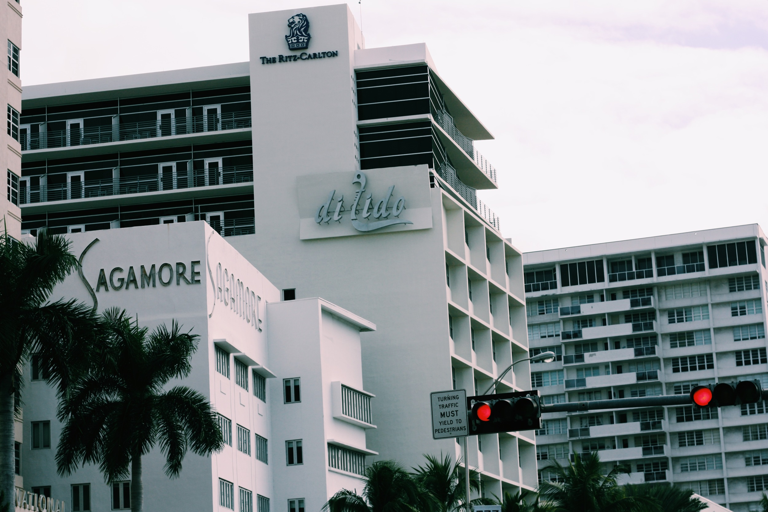 Art deco buildings line up the streets of South Beach, often bearing their names in geometric typefaces and bold colors.