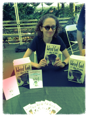 Meagan Brothers signs the very first issues of  Weird Girl and What's His Name .