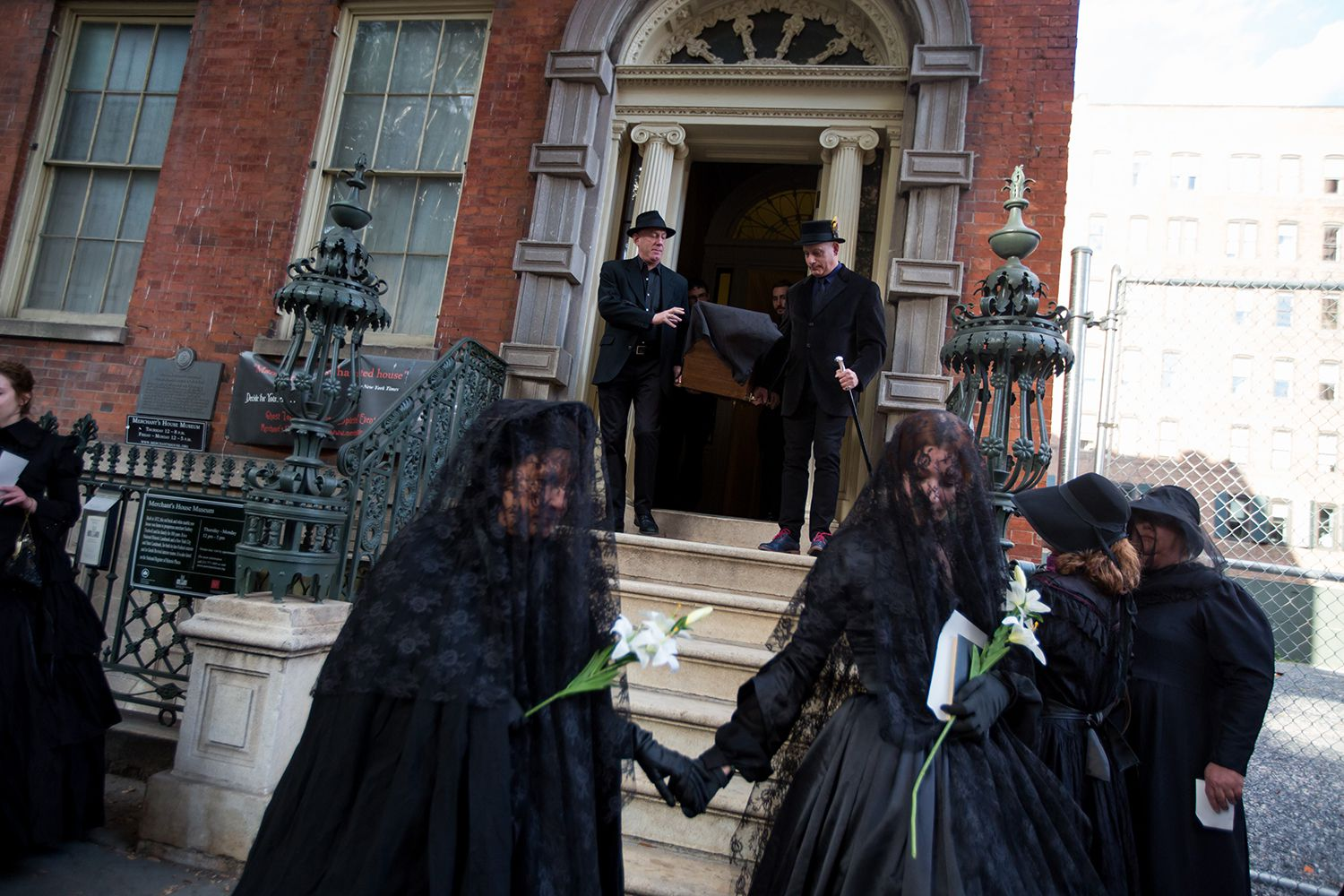 Roberta Belulovich (left) and I (right) as we begin the procession from the Merchant's House Museum.  (Michael Nagle for  Observer )