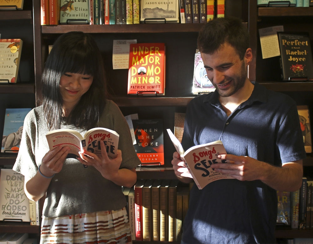 Songs of My Selfie contributors Xingyue Sarah He and Jared Shaffer reading at Flyleaf Books. Photo by Alex Kormann/The Daily Tar Heel.