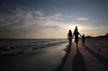 family-walking-on-beach.jpg