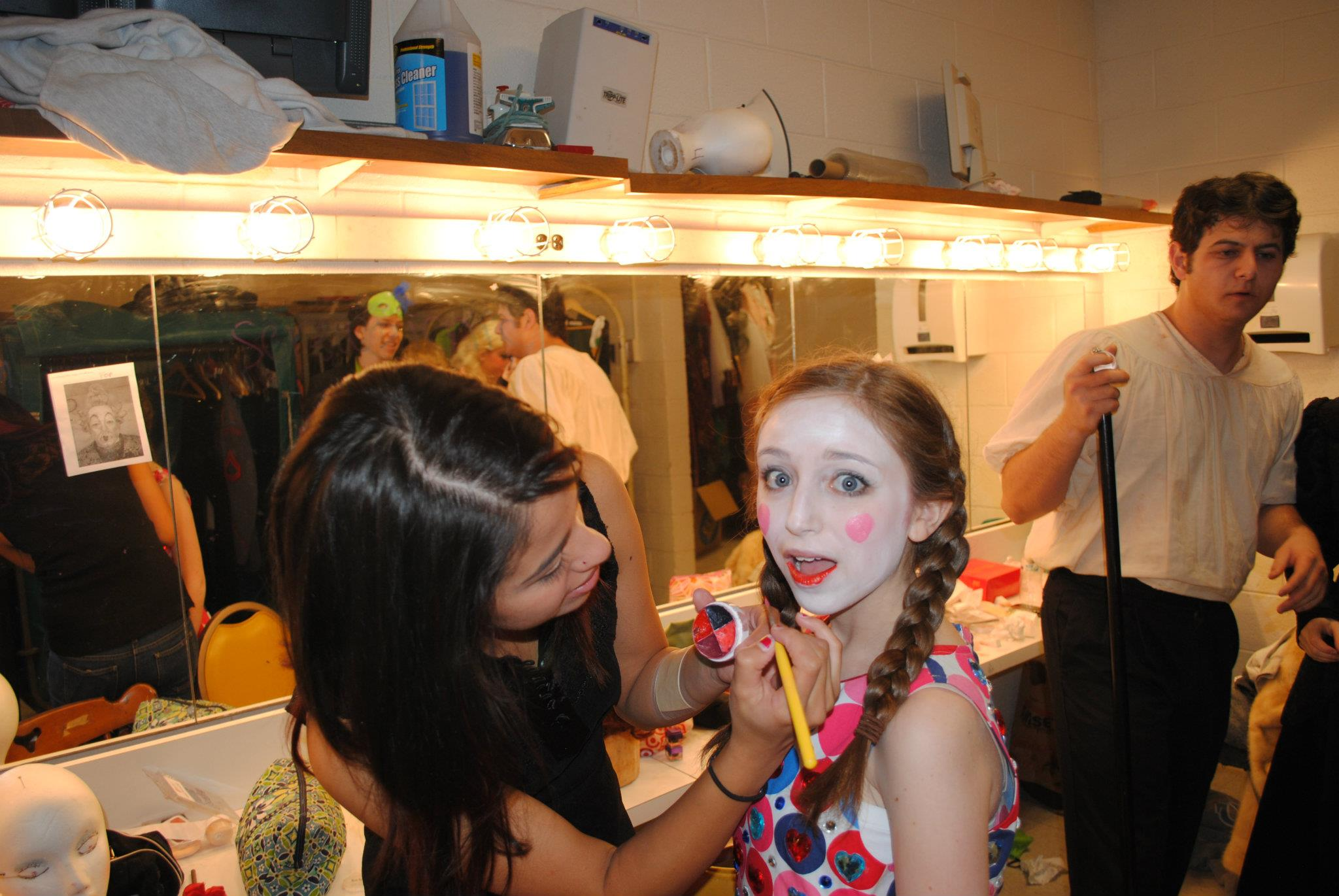 Me, in the early days of my passion for makeup doing makeup for my high school's theatre department