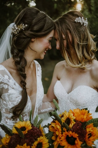 Barn wedding with sunflower bouquets