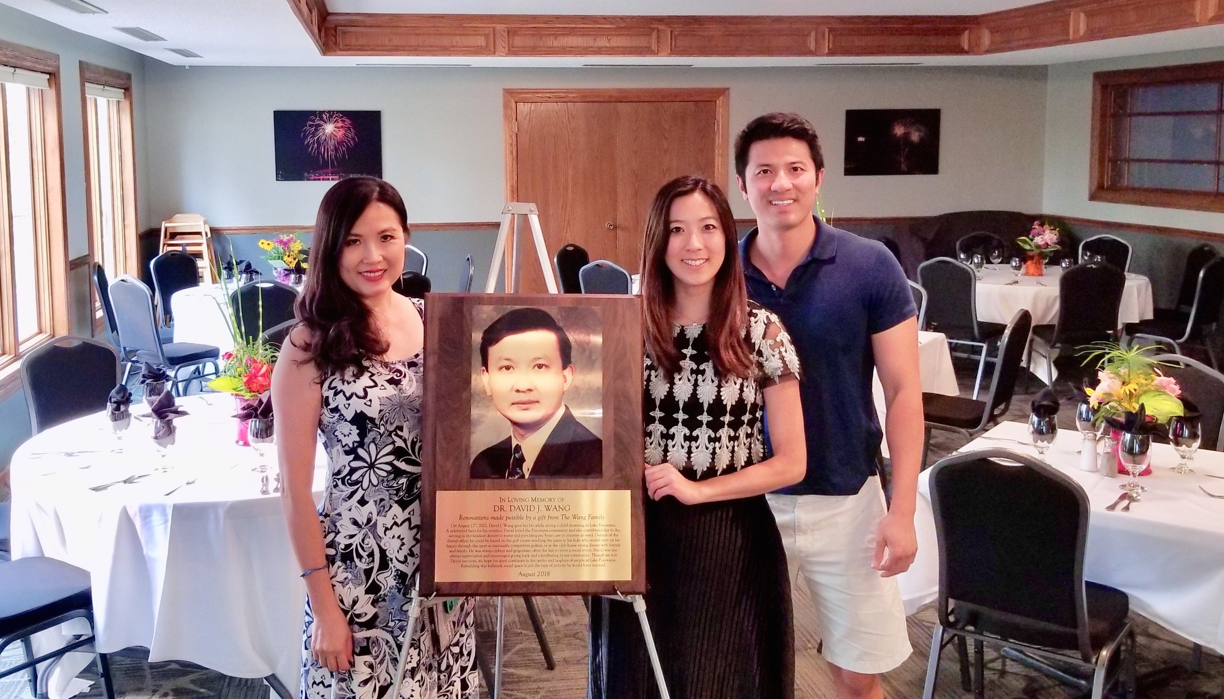 Cassie, Tony and Grace Wang are shown in the LPN dining room with a plaque honoring Dr. David Wang, who passed away in 2002. The Wang family made a donation to Friends of Lake Panorama in his memory, with some of the money used to update the dining room. The updates include new chairs, artwork, tables and tabletop accessories.