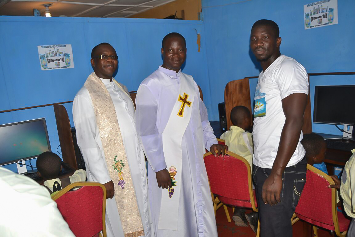 Father Bassey and Assistant with our IT guy, Kemoh Tarawally