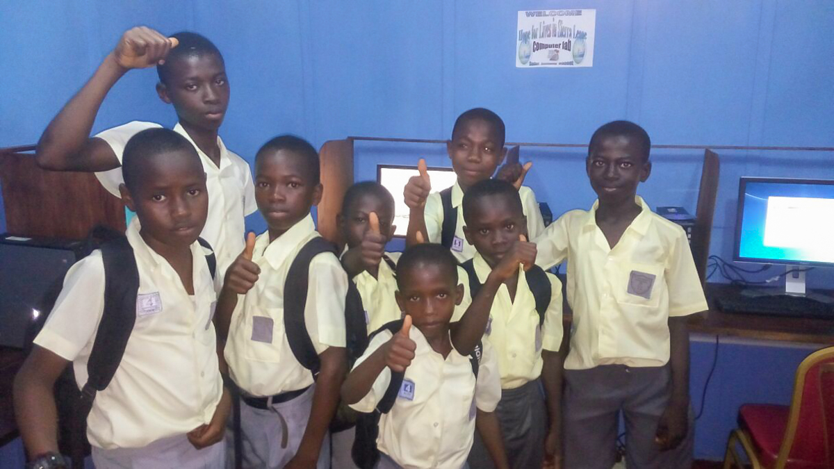 School kids giving their thumbs-up for the new computer lab